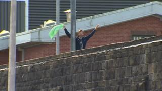An inmate has climbed up an internal fence at Cardiff prison