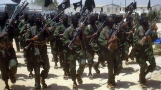Al-Shabab fighters perform military drills at a village about 25km outside Mogadishu