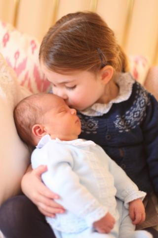 Third birthday portrait of Princess Charlotte, kissing baby brother Prince Louis on 2 May 2018