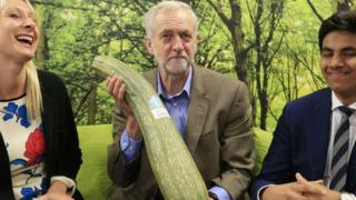 Jeremy Corbyn is presented with a marrow by local independent store during a visit to the Brighton