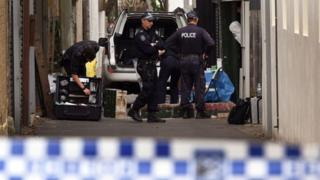 Police search for evidence at a home in Sydney's Surry Hills
