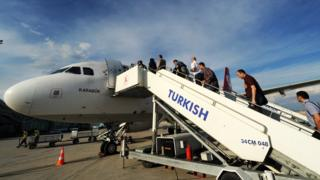 Passengers boarding a plane in Turkey - file pic