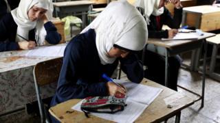 Girls in Yemen classroom take an exam in image taken in 2016