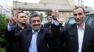 Mahmoud Ahmadinejad holds hands with former vice-president, Hamid Baghaei (12 April 2017)