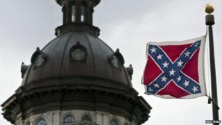 A Confederate flag flies outside the South Carolina State House in Columbia, South Carolina in a January 17, 2012