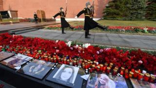 Portraits of the victims were laid out in Moscow as a tribute
