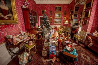 A room full of Christmas presents and decorations.