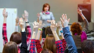 Children raising hands