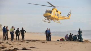 "A photo taken on 31 May, 2016, shows a rescue helicopter arriving to transport a critically injured surfer after a shark ripped off his leg in an attack in Australia""s west"
