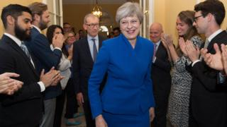 Theresa May arrives back in Downing Street after forming a government