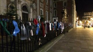 Scarves hanging on the railings outside Worcester Guildhall