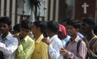 Indian youth queue at a jobs fair in Mumbai on October 12, 2011. C