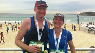 Peter and Lisa Bayliss at a beach following a run in Sydney