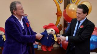 Left-right: Hugh Bonneville, Paddington, Hugh Grant