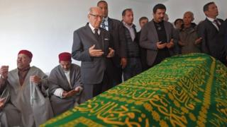 Tunisian President Beji Caid Essebsi prays during the funeral of the late Tunisian fashion designer Azzedine Alaia, who died this month aged 77, in the Sidi Bou Said cemetary in the capital Tunis on November 20, 2017