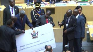President Mugabe with the cheque