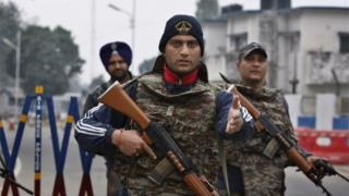 Indian soldiers stand guard at the airbase in Pathankot, India, Monday, Jan. 4, 2016.
