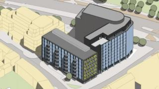 An artist's impression of the hotels and new homes at the site