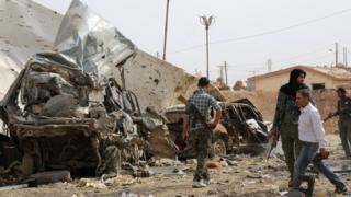 Aftermath of Islamic State (IS) bomb attack on Kurdish YPG checkpoint north of the city of Hassakeh, Syria (14 September 2015)