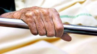 Elderly patient in a bed