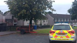 Police car outside flat in Meelmore Drive in Omagh