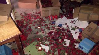 Poppies scattered around storage facility in Caernarfon