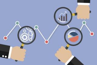 Magnifying glasses analysing data
