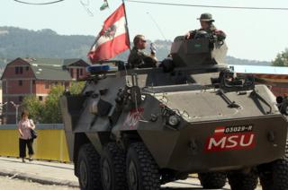 Austrian APC on patrol in Kosovo, Sept 2012 file pic
