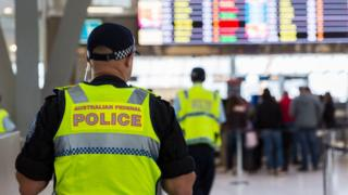 An Australian Federal Police officer at Sydney Airport