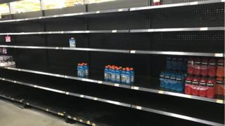 Bare shelves at a Walmart in Houston