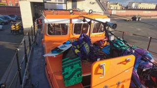 Kites and boards were brought ashore by the RNLI's Rhyl all-weather lifeboat