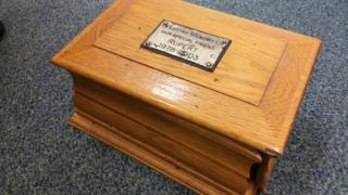 Wooden box containing ashes