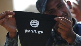 Iraklı güvenlik görevlisi