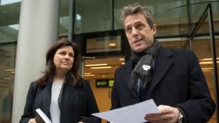 Hugh Grant and Crimewatch presenter Jacqui Hames, who also settled a phone-hacking claim, speaking after the hearing in London