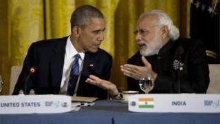 """President Barack Obama talks with India""""s Prime Minister Narendra Modi during a working dinner with heads of delegations of the Nuclear Security Summit in the East Room of the White House, in Washington, Thursday, March 31, 2016."""