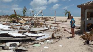 Sira Berzas surveys the ruins of her Pink Sand Beach bar and restaurant
