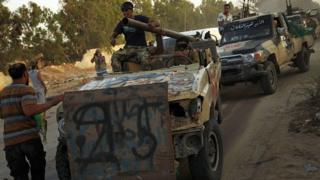 Des miliciens rentrent à Benghazi après avoir libéré la ville des mains d'autres forces rivales