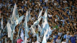 Argentina's Racing Club supporters cheer during their Copa Sudamericana football match against Colombia's Rionegro Aguilas