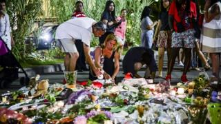 Floral tributes are placed where scores of people were killed on the Promenade des Anglais, Nice, last week