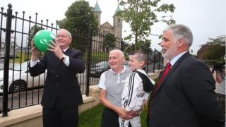 Martin McGuinness attended a community celebration marking the replacement of the Ardoyne peace wall