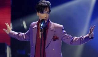 Prince performs in a surprise appearance on American Idol