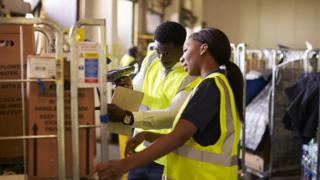 stock image of workers in a warehouse