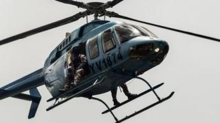 """Security forces overfly Venezuela""""s third city, Valencia, as anti-government activists demonstrate, 6 August"""