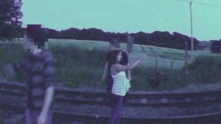 Girl taking selfie on railway track
