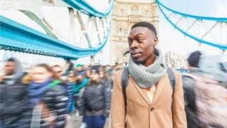 young man on Tower Bridge