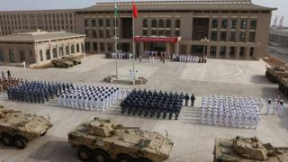 Chinese People's Liberation Army staff attend the opening ceremony of China's new military base in Djibouti. China has deployed troops to its first overseas naval base in Djibouti.