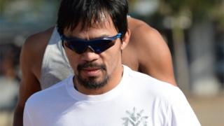 Philippine boxing great Manny Pacquiao (front) jogs along the sports complex in General Santos on the southern island of Mindanao on February 19, 2016