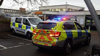 Police vehicles outside Forest Hill station