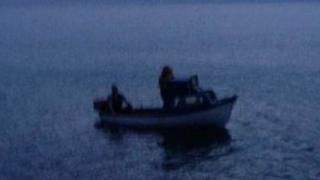 Couple stranded on dinghy