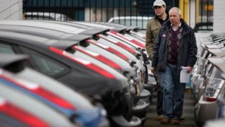customers at car dealership
